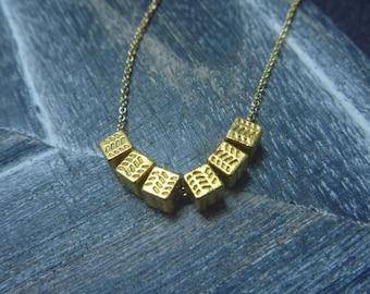 Necklace gold cubes