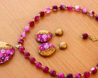Pink and golden clay jewellery set.
