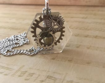 Steampunk Pendant , hexagon resin , gear wheel and apple charms