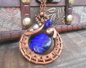 Round Copper wire wrapped pendant Stargate with the blue stone Necklace an original work Eco-friendly Copper Round Wire wraped blue Coulomb