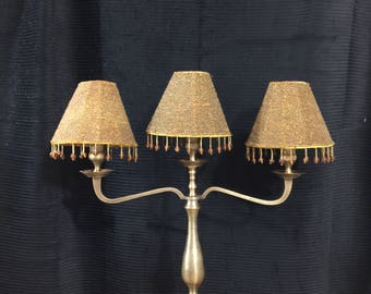 Vintage brass 3-bowl candle holder with beaded lamp shades, made in India.