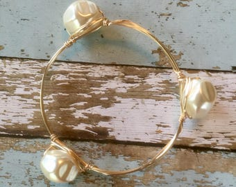 Chunky pearl and gold bangle bracelet