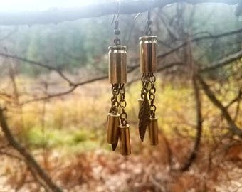 9mm bullet shell with .22 shells and feather chandelier earrings