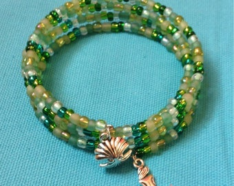Under the sea green beaded memory-wire bracelet with mermaid and clam charms