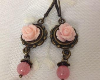 Earrings in pink resin roses clips.