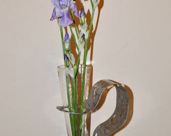 forged metal stand and vase