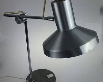 Old and very beautiful original articulated vintage 1960 form desk lamp.