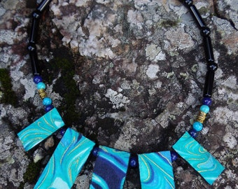 Turquoise abstract swirl fabric covered pendant necklace 44cm by Andrew Paget