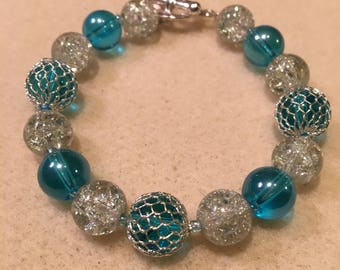 Glass-Beaded Stretch Bracelet with silver toggle clasp.