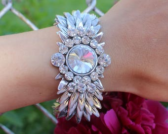 Silvertone metal leaf link bracelet with clear stones