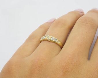 Fine ring set with diamonds 14 K