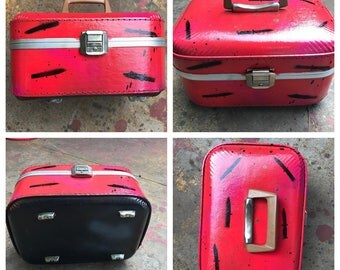 Hand painted, upcycled vintage travel makeup case.