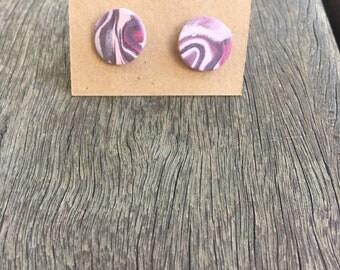 Pink marbelled clay stud earrings.