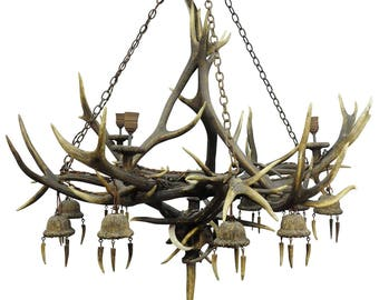 an enormous antique antler chandelier with 12 spouts ca. 1880s