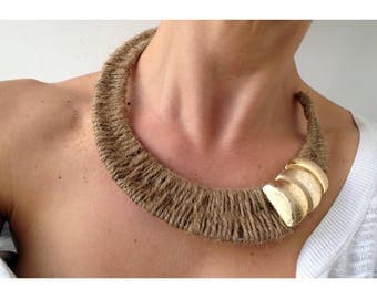 golden, brown, stiff, adjustable necklace