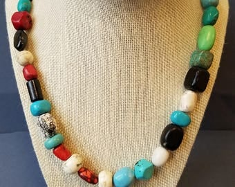 Stone bead necklace with turquoise red white and black beads