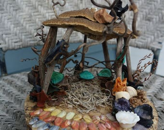Hippy pixie gazebo made of grape vines, fungus and other natural materials found in the forest.