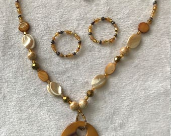 Gold and brown 22 inch necklace with pendent and earrings