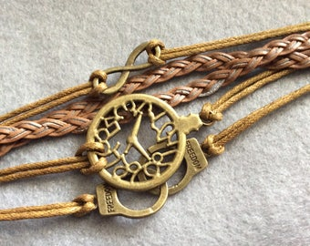 Steampunk style multistranded bracelet. time infinity