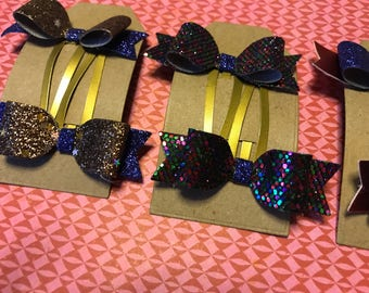 Small glitter bows on snap clips