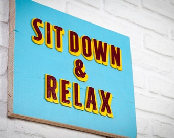 Poster of recycled wood - Sit Down & Relax - embossed letters