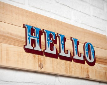 Poster of recycled wood with embossed - Hello - wooden letters