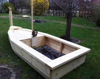Sand box as a boat and a rocking tractor