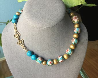 Turquoise colored cloisonne necklace made with brass beads and matching earrings