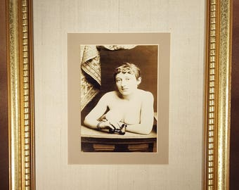 REPRODUCTION:  antique photo of a nude young woman holding opera glasses, c.1900, double matte, in modern frame