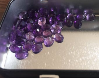 44 small faceted oval amethyst stones