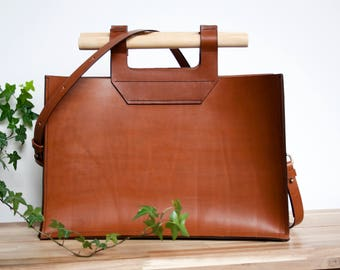 Minimalist hand stitched leather bag