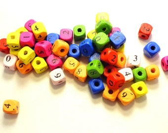 50 multicolored cubes with 10mm black wood beads