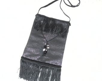 Fabric evening bag style roaring twenties with fringes and beads.