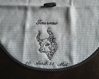 Taurus: round towel nideponge fabric lined with a bias and embroidered design