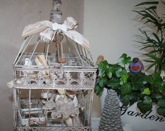 Bird cage and decorative elements of charm