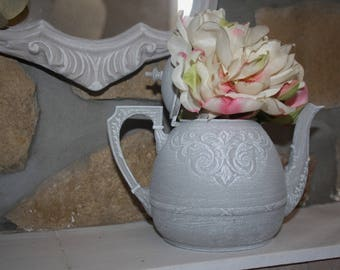 Vase charm revisited from a silver plated teapot