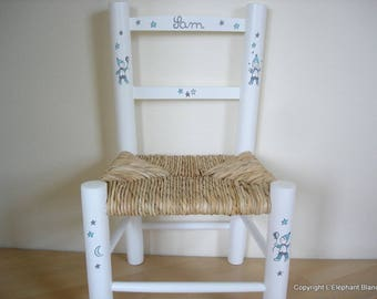 White straw Chair decorated with the name of child