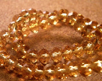 35 Austrian Crystal faceted glass beads - amber - 8 mm x 6 mm - PE73