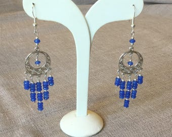 Long earrings tiny blue stones and silver metal.