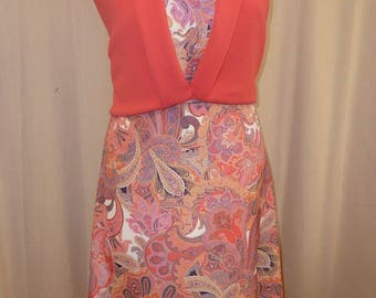 Pink/orange fabric with Paisley print