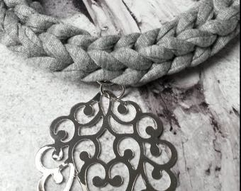 Grey hand crocheted necklace with a silver print