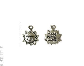 "15 antique ""Sun"" - silver charms"