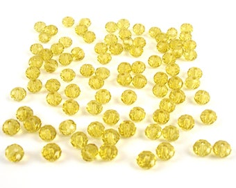 40 6 mm faceted glass beads, straw yellow color