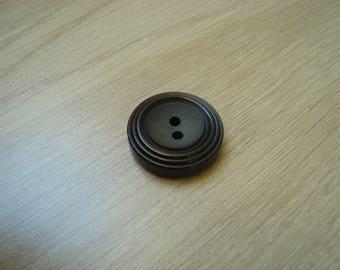 dark brown round shape button