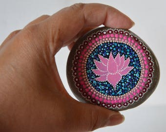 Painting on stone with mandala and lotus