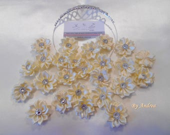 Applique fabric flowers in white satin with Rhinestones.