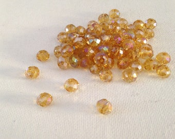 12 Crystal beads faceted, iridescent, 6 X 4 mm champagne color