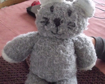 knitted gray and white cat