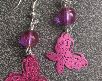 pair of pink butterfly earrings