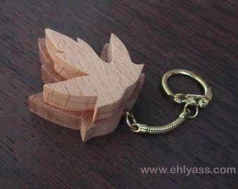 Keychain / bag made of solid wood maple leaf charm made of fretwork